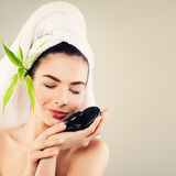 Spa Woman with White Bath Towel, Green Bamboo Leaves Stock Photo