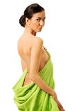 Spa woman wrapped in towel Royalty Free Stock Photos