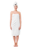 Spa woman wrapped in white towel Stock Photos