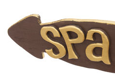 Spa. Wooden pointer in the shape of the arrow with the word spa on a white background Royalty Free Stock Image