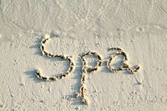 'Spa' written in sand. Stock Photo
