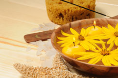 Spa with yellow flowers and candles Royalty Free Stock Image