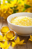 Spa with yellow herbal bath pearls and flowers Stock Photo