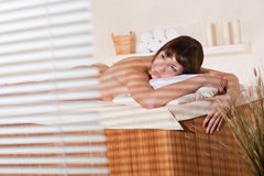 Spa - Young female client at wellness massage Royalty Free Stock Photos