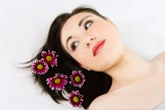 Spa young woman with flower chrysanthemum Royalty Free Stock Photo