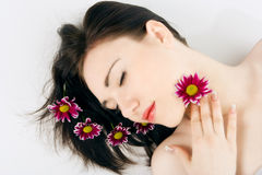 Spa young woman with flower chrysanthemum Royalty Free Stock Images