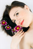 Spa young woman with flower chrysanthemum Stock Photography