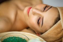 Spa. Young woman on massage table in beauty spa salon stock photos
