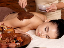 Spa for young woman receiving cosmetic mask Royalty Free Stock Images