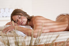 Spa - Young woman relax at massage treatment Royalty Free Stock Photo