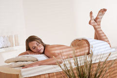 Spa - Young woman relax at wellness treatment Stock Photos