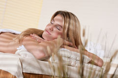 Spa - Young woman at wellness massage treatment Stock Photos