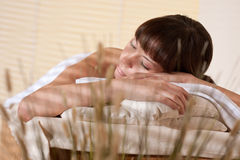 Spa - Young woman at wellness therapy. Enjoy massage royalty free stock photos