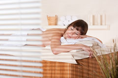 Spa - Young woman at wellness therapy. Waiting for massage stock image