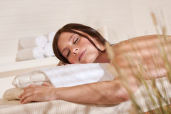 Spa - Young woman at wellness therapy massage Royalty Free Stock Images
