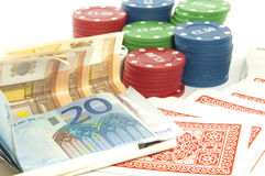 Spaanders en geld op wit Stock Foto's