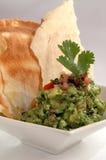 Spaanders en guacamole stock afbeeldingen