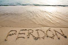 Spaans die woord perdà ³ n in het zand wordt geschreven Royalty-vrije Stock Afbeeldingen