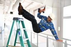 Spaanse Arbeider die van Ladder vallen Stock Fotografie