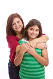 Spaanse die moeder en dochter op wit wordt geïsoleerd Royalty-vrije Stock Foto's