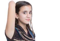 In Spaanse die tiener op een witte achtergrond wordt geïsoleerd royalty-vrije stock afbeelding