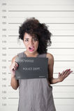 Spaanse donkerbruine modelafro als haar het dragen Stock Foto