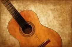 Spaanse gitaar op grungeachtergrond Stock Afbeelding