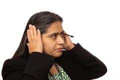 Spaanse Onderneemster Puts On Headset voor Vraag stock foto