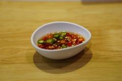 Spaanse peper en vissensaus Stock Afbeeldingen