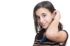 In Spaanse tiener die op wit wordt geïsoleerd stock afbeelding