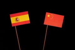 Spaanse vlag met Chinese vlag op zwarte royalty-vrije stock afbeeldingen