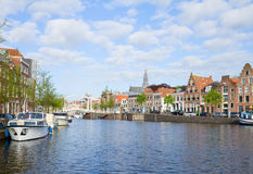Spaarne river with boats in old Haarlem, Holland. Spaarne river with boats and historical houses in old Haarlem, Holland Stock Photos