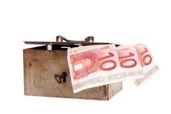 Spaarpot met bankbiljetten van tien euro Stock Foto's