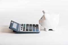 Spaarvarken & calculator Royalty-vrije Stock Afbeelding