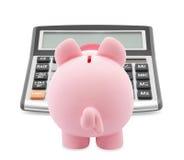 Spaarvarken en calculator Stock Afbeeldingen