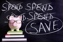 Spaarvarken met besparingenbericht Stock Afbeeldingen