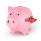 Spaarvarken met Creditcard Royalty-vrije Stock Afbeelding