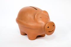 Spaarvarken met glimlach Stock Foto