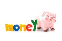 Spaarvarken met het woordGeld Royalty-vrije Stock Foto