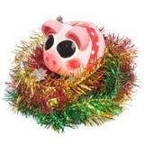 Spaarvarken met Kerstmisdecoratie Stock Afbeeldingen