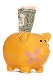 Spaarvarken met pleister en één dollarrekening Stock Foto