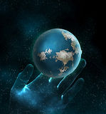 Space. Blue planet and the hand in space Royalty Free Stock Images