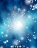 Space. Rays of light burst out of blue Royalty Free Stock Photos