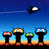 Space aliens. On a planet with a flying saucer flying by Royalty Free Illustration