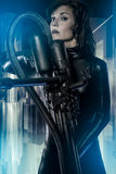 Space, armed woman in a garage, future concept, black latex with Stock Photography