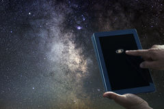Space Astronomy Exploration Concept. Saturn planet tablet. Stock Photo