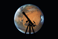 Space background with silhouette of telescope. Mars planet Royalty Free Stock Photo