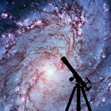Space background with silhouette of telescope. Messier 83. Southern Pinwheel Galaxy, M83 in the constellation Hydra. Elements of this image are furnished by stock image