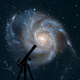 Space background with silhouette of telescope. Pinwheel Galaxy royalty free stock image