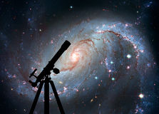 Space background with silhouette of telescope. Stellar Nursery Stock Images